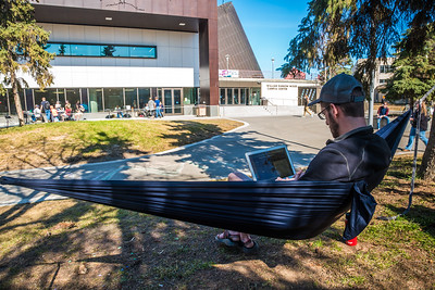Students enjoy some spring sunshine and warm temperatures in late April on the Fairbanks campus.  Filename: LIF-16-4877-16.jpg