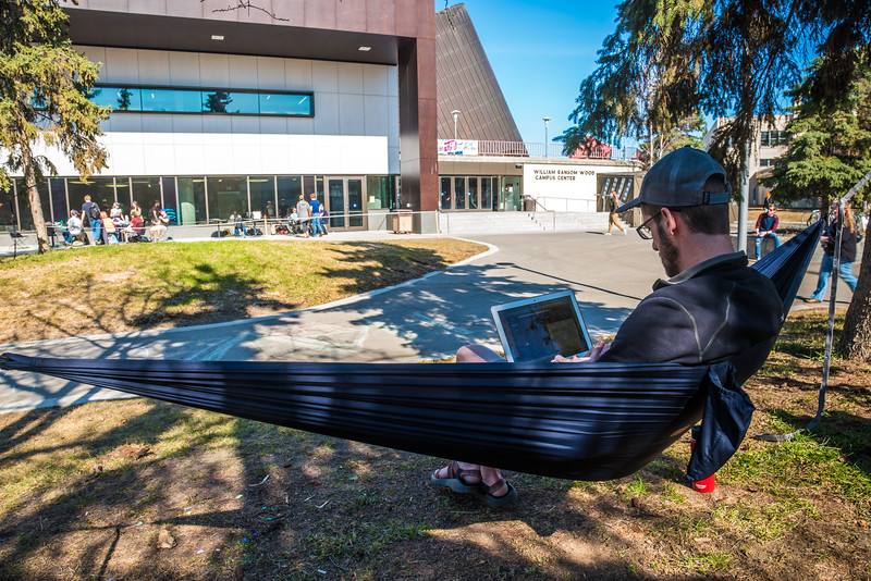 """Students enjoy some spring sunshine and warm temperatures in late April on the Fairbanks campus.  <div class=""""ss-paypal-button"""">Filename: LIF-16-4877-16.jpg</div><div class=""""ss-paypal-button-end""""></div>"""