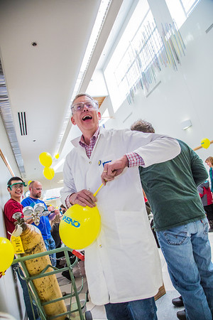 Chemistry Professor Tom Green serves up fresh balloons during this year's Science Potpourri in the Reichardt Building.  Filename: LIF-13-3791-43.jpg