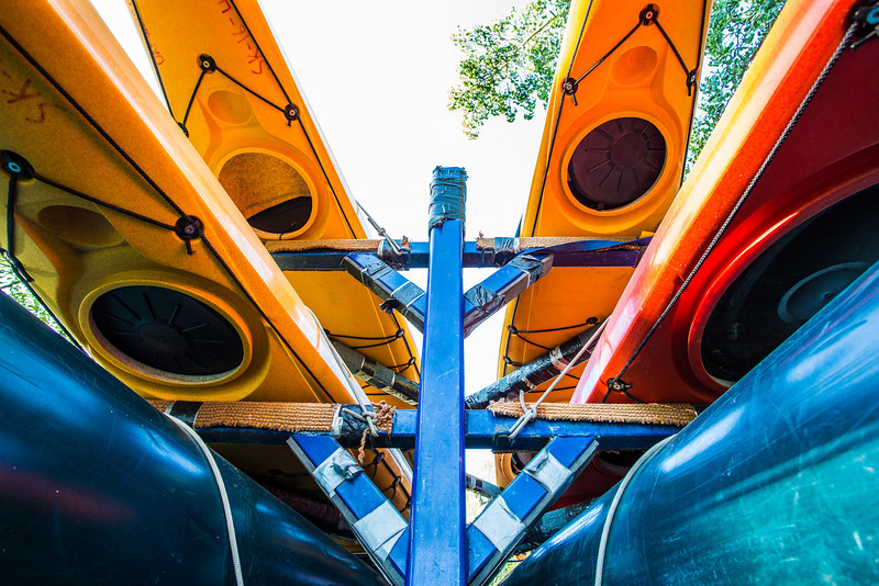 """Canoes and kayaks rest on racks near UAF's Wood Center when not being used by the Outdoor Adventures program.  <div class=""""ss-paypal-button"""">Filename: LIF-12-3476-12.jpg</div><div class=""""ss-paypal-button-end"""" style=""""""""></div>"""