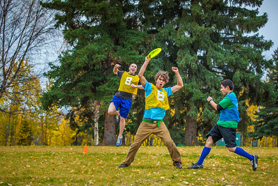 Logan Howlett, in air at left, celebrates a score with Adam McCombs during an ultimate frisbee scrimmage on campus.  Filename: LIF-12-3557-115.jpg