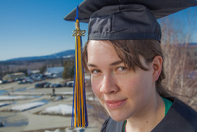 Senior foreign languages major Lindsey Miller poses in her cap and gown on the roof of the Brooks Building on the Fairbanks campus.  Filename: LIF-12-3352-98.jpg