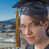 "Senior foreign languages major Lindsey Miller poses in her cap and gown on the roof of the Brooks Building on the Fairbanks campus.  <div class=""ss-paypal-button"">Filename: LIF-12-3352-98.jpg</div><div class=""ss-paypal-button-end"" style=""""></div>"