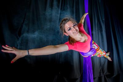Murial Berg is an active member of the silk club at UAF, in which members perform acrobatic stunts hanging from silks.  Filename: LIF-14-4133-73.jpg