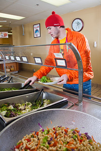 Freshman Logan Pitney loads up on vegetables during lunch in the Lola Tilly Commons.  Filename: LIF-11-3220-059.jpg