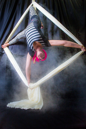 Lindsey Dreese is an active member of the silk club at UAF, in which members perform acrobatic stunts hanging from silks.  Filename: LIF-14-4133-26.jpg