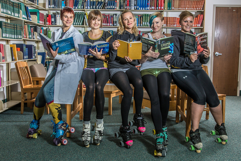 "Members of the Fairbanks Roller Derby league pose for a promotional reading poster in the Rasmuson Library on the Fairbanks campus. The skaters are all students or employees at UAF.  <div class=""ss-paypal-button"">Filename: LIF-13-3950-32.jpg</div><div class=""ss-paypal-button-end"" style=""""></div>"