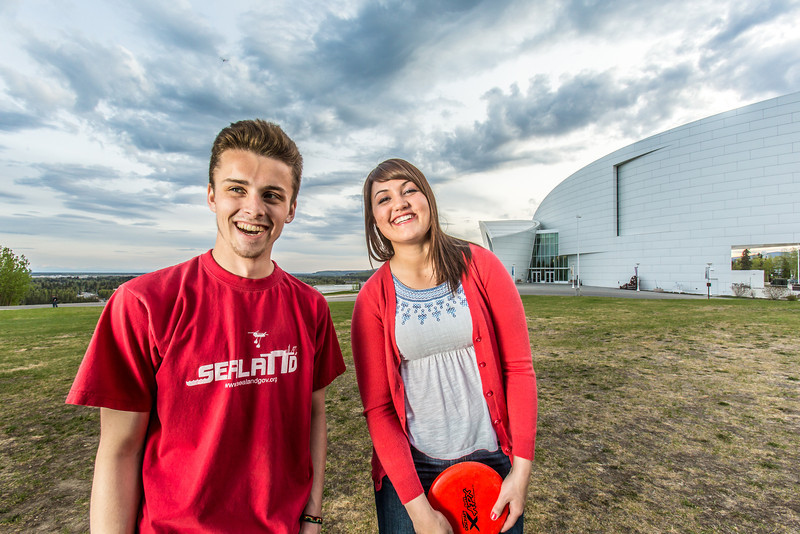 """Friends Aaron Druyvestein and Serena McCormick enjoy a round of disc golf on the campus course near the University of Alaska Museum of the North.  <div class=""""ss-paypal-button"""">Filename: LIF-14-4191-79.jpg</div><div class=""""ss-paypal-button-end"""" style=""""""""></div>"""