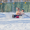 """Bryan Johnson, front, and his buddy Jimmy Donohue spend some quality time on the UAF sledding hill on a nice February afternoon.  <div class=""""ss-paypal-button"""">Filename: LIF-12-3290-58.jpg</div><div class=""""ss-paypal-button-end"""" style=""""""""></div>"""