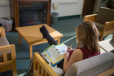Music education major Anna Polum finds a comfortable spot to study in the Rasmuson Library.  Filename: LIF-13-3950-38.jpg