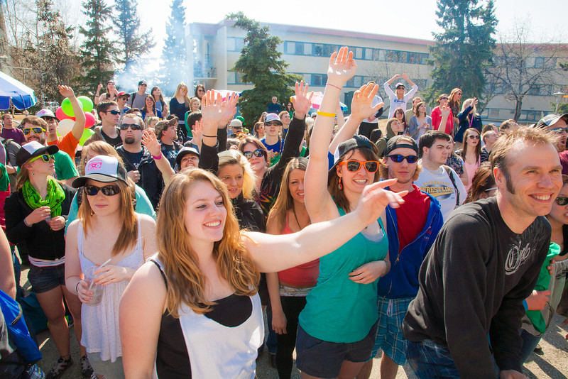 """Students in front of the Wood Center watch the dance off during the Spring Fest kick-off barbeque.  <div class=""""ss-paypal-button"""">Filename: LIF-12-3375-234.jpg</div><div class=""""ss-paypal-button-end"""" style=""""""""></div>"""