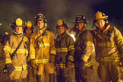 University firefighters stop and pose for a portrait at the 2012  Filename: LIF-12-3573-41.jpg