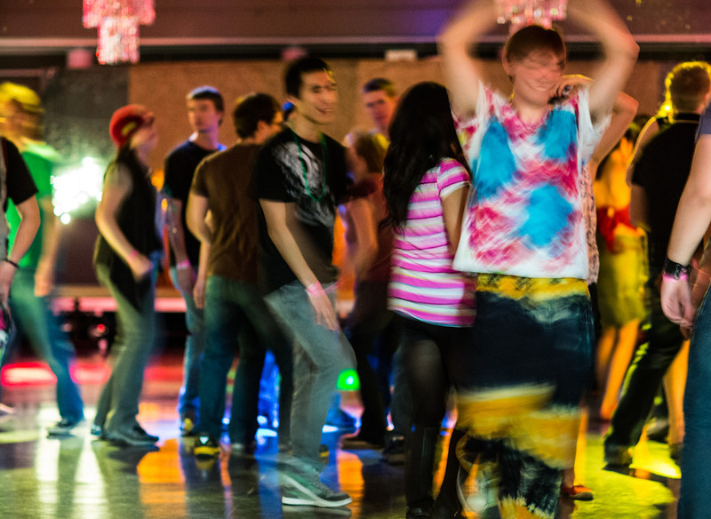 """Students boogie with the music at a Mardi Gras themed dance at the Hess Rec. Center on campus.  <div class=""""ss-paypal-button"""">Filename: LIF-13-3740-27.jpg</div><div class=""""ss-paypal-button-end"""" style=""""""""></div>"""