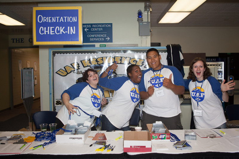 """Orientation Leaders pose for a portrait at the Check-In station Sunday, August 26, 2012 during Move-In Day at the Moore, Bartlett, Skarland dormitory complex.  <div class=""""ss-paypal-button"""">Filename: LIF-12-3511-173.jpg</div><div class=""""ss-paypal-button-end"""" style=""""""""></div>"""