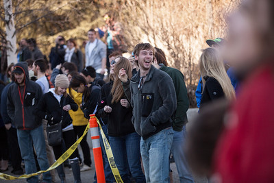 Justin Calkins and other students congregate on the base of the Gruening Building to watch the annual Spring Fest watermelon drop.  Filename: LIF-13-3799-171.jpg