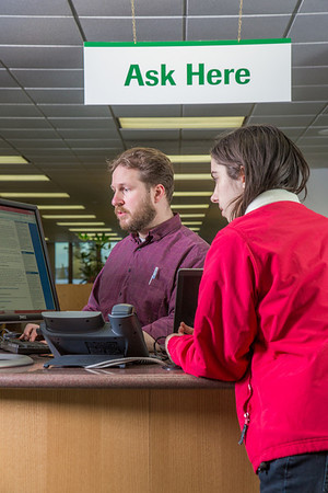 Staff librarian Paul Adasiak, left, helps justice major Kristie Major with a reference question in the UAF Rasmuson Library on the Fairbanks campus.  Filename: LIF-14-4045-198.jpg