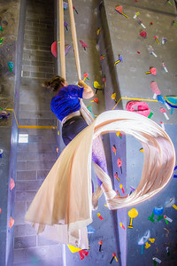 Graduate student Stephany Jeffers practices her silk climbing skills in the SRC.  Filename: LIF-13-3819-110.jpg