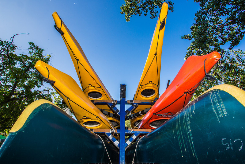 """Canoes and kayaks rest on racks near UAF's Wood Center when not being used by the Outdoor Adventures program.  <div class=""""ss-paypal-button"""">Filename: LIF-12-3476-20.jpg</div><div class=""""ss-paypal-button-end"""" style=""""""""></div>"""