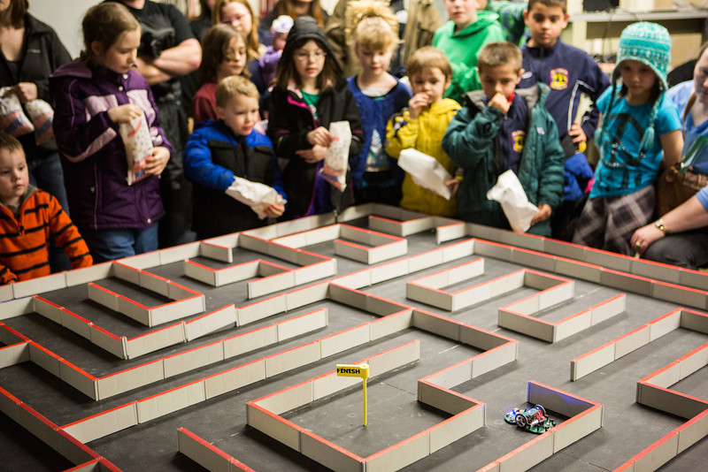 """With bags of popcorn on hand, youngsters watch an electronic mouse navigate a labyrinth during the E-Week open house in the Duckering Building.  <div class=""""ss-paypal-button"""">Filename: LIF-13-3741-33.jpg</div><div class=""""ss-paypal-button-end"""" style=""""""""></div>"""