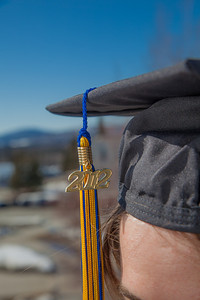 Senior foreign languages major Lindsey Miller poses in her cap and gown on the roof of the Brooks Building on the Fairbanks campus.  Filename: LIF-12-3352-93.jpg