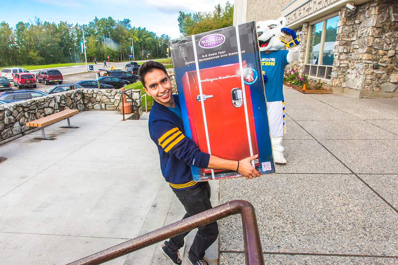 """Returning students, staff and parents all pitch in to help new arrivals move into the residence halls during Rev It Up on the Fairbanks campus at the beginning of the fall 2015 semester.  <div class=""""ss-paypal-button"""">Filename: LIF-15-4636-140.jpg</div><div class=""""ss-paypal-button-end""""></div>"""
