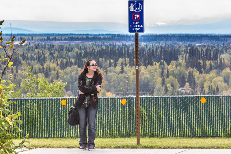 """Undergraduate Rebekah Brown waits for the shuttle bus outside the Reichardt Building on the first day of class of the 2013 fall semester.  <div class=""""ss-paypal-button"""">Filename: LIF-13-3928-70.jpg</div><div class=""""ss-paypal-button-end"""" style=""""""""></div>"""