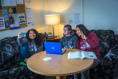 Undergraduates Kisha Lee, left, Michaela Lockes and Dyane Chung take a group selfie from the student lounge at UAF's Kuskokwim Campus in Bethel.  Filename: LIF-16-4859-138.jpg