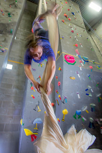 Graduate student Stephany Jeffers practices her silk climbing skills in the SRC.  Filename: LIF-13-3819-166.jpg