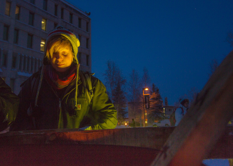 """Emily Smola puts in her time at the week-long homeless vigil maintained 24-hours-a day in Constitution Park by students in the UAF Honors Program. The temperature at the time was a brisk -30°.  <div class=""""ss-paypal-button"""">Filename: LIF-13-4002-6.jpg</div><div class=""""ss-paypal-button-end"""" style=""""""""></div>"""