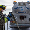 "Aaron Stevens rolls a fire hose after filling an outdoor ice rink for children at Ice Alaska's George Horner Ice Park in Feb. 2013.  <div class=""ss-paypal-button"">Filename: LIF-12-3723-111.jpg</div><div class=""ss-paypal-button-end"" style=""""></div>"