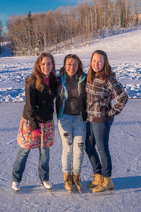 Undergraduates Sarah Riopelle, left, Rise Crelli, center, and Annalisa Taylor find time between classes to have fun on the ice rink in front of the SRC on a sunny January afternoon.  Filename: LIF-15-4428-80.jpg
