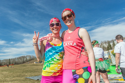 Kira Leonard, left, and Joanna Jagow pose after running in the Mustache Dash during SpringFest on April 28.  Filename: LIF-14-4168-57.jpg