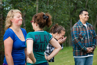 Iris Fletcher, left, tries to keep a straight face as Kelly Kohler makes her smile during during a team building activity for UAF resident assistants Thursday, August 16, 2012 at the lawn in front of the MBS Complex. About 40 RAs attended the training before students attending the fall semester enter the residence halls.  Filename: LIF-12-3498-24.jpg