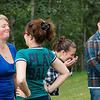 "Iris Fletcher, left, tries to keep a straight face as Kelly Kohler makes her smile during during a team building activity for UAF resident assistants Thursday, August 16, 2012 at the lawn in front of the MBS Complex. About 40 RAs attended the training before students attending the fall semester enter the residence halls.  <div class=""ss-paypal-button"">Filename: LIF-12-3498-24.jpg</div><div class=""ss-paypal-button-end"" style=""""></div>"