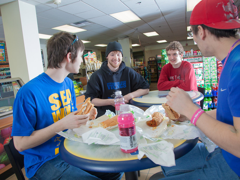 """Students Quinn Verfaillie, left, and Robert Doerning enjoy sandwiches in the Campus Cache, located in the Moore-Bartlett-Skarland residence hall complex on the Fairbanks campus.  <div class=""""ss-paypal-button"""">Filename: LIF-12-3339-30.jpg</div><div class=""""ss-paypal-button-end"""" style=""""""""></div>"""