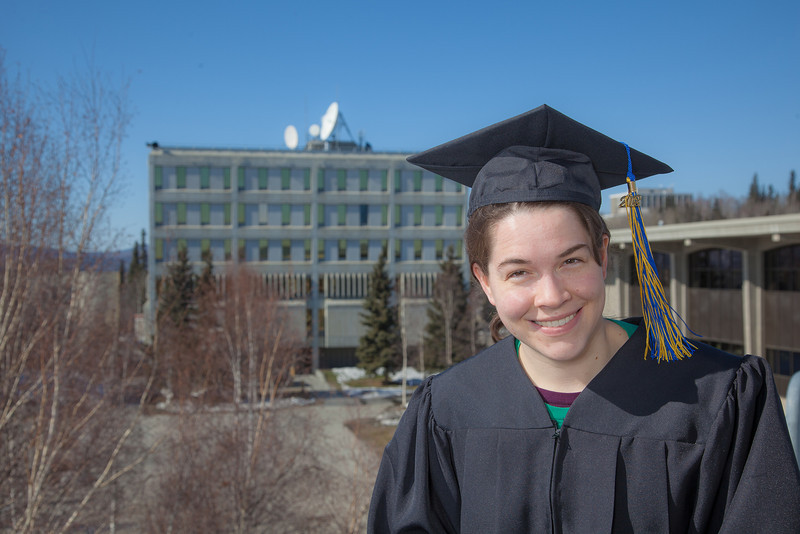"Senior foreign languages major Lindsey Miller poses in her cap and gown on the roof of the Brooks Building on the Fairbanks campus.  <div class=""ss-paypal-button"">Filename: LIF-12-3352-12.jpg</div><div class=""ss-paypal-button-end"" style=""""></div>"