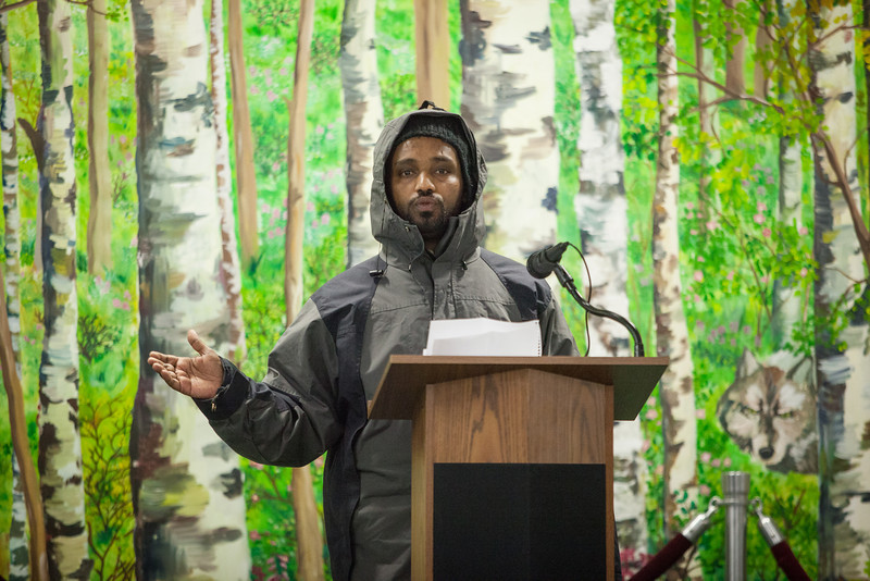 """Abraham Endalamaw of Ethiopia, informs a handful of students, faculty, and community members about his country during a flag dedication ceremony at the Wood Center.  <div class=""""ss-paypal-button"""">Filename: LIF-12-3655-18.jpg</div><div class=""""ss-paypal-button-end"""" style=""""""""></div>"""