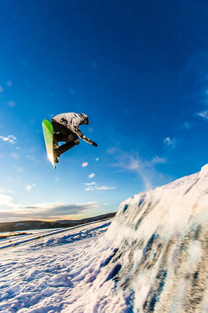 Students enjoy some of the features of UAF's terrain park on a spring afternoon.  Filename: LIF-13-3746-44.jpg