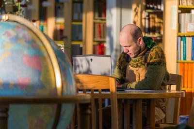 Senior math major David Leonard catches up on some studying on the 5th floor of the Rasmuson Library.  Filename: LIF-14-4045-3.jpg