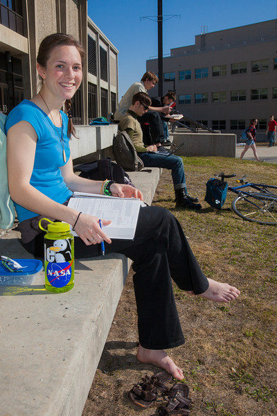 """Rebekah Tsigonis goes barefoot while enjoying some nice weather outside on campus after a long winter.  <div class=""""ss-paypal-button"""">Filename: LIF-12-3356-47.jpg</div><div class=""""ss-paypal-button-end"""" style=""""""""></div>"""
