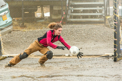 UAF graduate student Ludda Ludwig makes a save in net during a wet and muddy soccer match on a summer night at the Toolik Field Station on Alaska's North Slope.  Filename: LIF-14-4216-132.jpg