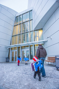 A parent leads his children into the Halloween party at the University of Alaska Museum of the North.  Filename: LIF-13-3988-2.jpg