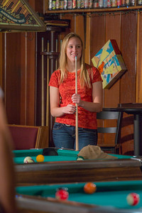 Students unwind over a game of pool in the Wood Center Pub on the Fairbanks campus. (Note: Taken as part of commercial shoot with Nerland Agency -- use with discretion!)  Filename: LIF-12-3563-014.jpg