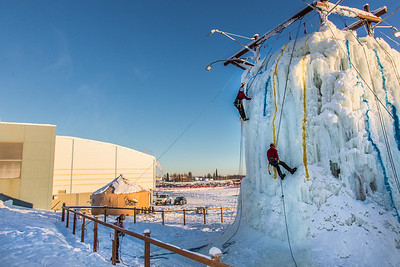 Organizers make a trial run up the ice wall before opening it up for competition during a 2014 Winter Carnival event.  Filename: LIF-14-4084-1.jpg