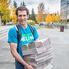 "Distribution manager Shaun Nesheim leaves Wood Center with a recent edition of the Sun Star.  <div class=""ss-paypal-button"">Filename: LIF-12-3555-02.jpg</div><div class=""ss-paypal-button-end"" style=""""></div>"