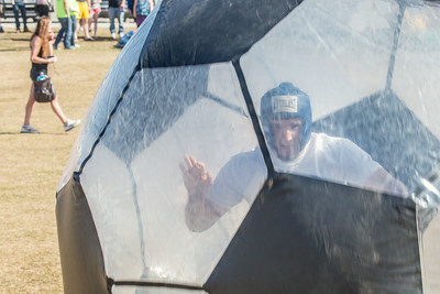 Participants had fun running inside the inflatable balls during SpringFest Field Day April 28.  Filename: LIF-14-4168-166.jpg