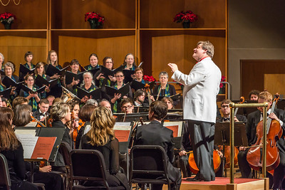 Conductor Eduard Zilberkant gets the attention of members of the Fairbanks Symphony Orchestra along with the Fairbanks Symphony Chorus before another selection during the annual holiday concert in the Davis Concert Hall.  Filename: LIF-13-4016-71.jpg