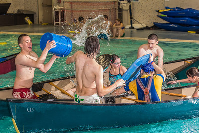 Battleship is a popular intramural sport at UAF. Teams in canoes try to swamp each other's boats during a tournament in the Patty pool.  Filename: LIF-13-3975-63.jpg
