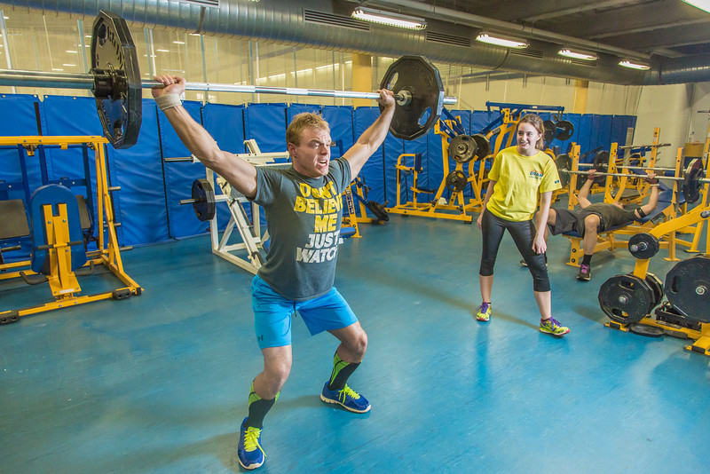 """Gavin Meggert pumps some iron during a workout in the Student Recreation Center under the guidance of a student trainer.  <div class=""""ss-paypal-button"""">Filename: LIF-14-4111-76.jpg</div><div class=""""ss-paypal-button-end"""" style=""""""""></div>"""