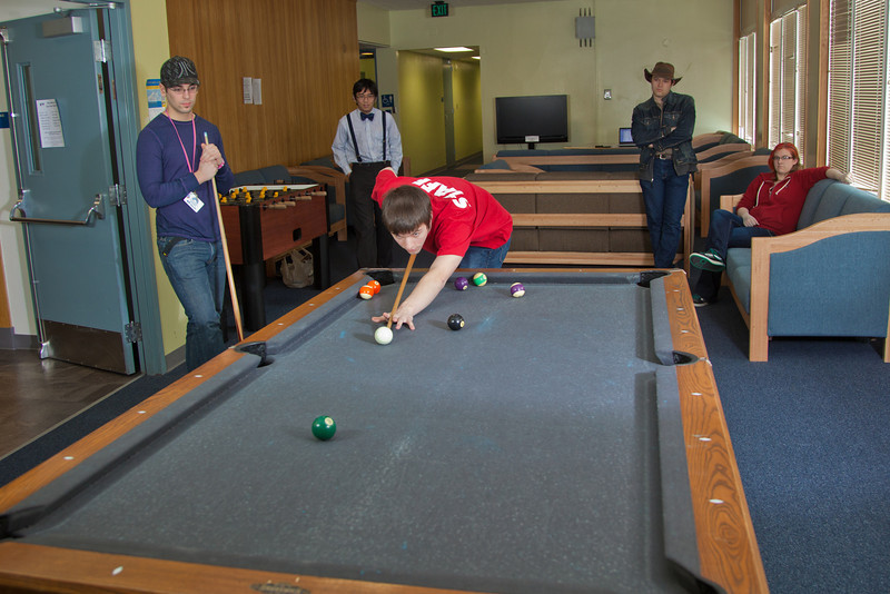 "Junior computer science major Quinn Verfaillie plays some pool with other residents in the Skarland Hall lounge.  <div class=""ss-paypal-button"">Filename: LIF-12-3322-011.jpg</div><div class=""ss-paypal-button-end"" style=""""></div>"